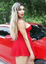 Breathtakingly HOT Shemale in Red Dress in a RED CAMARO