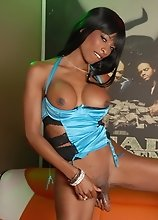 Horny ebony TS babe toying her ass and jerking off