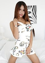 Busty tattooed Thai ladyboy gets white cock stuffed up her ass