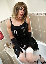 Horny TGirl slut Zoe enjoys playing with her big cock and dildo toys in the bathroom