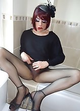 Sexy tgirl slut Zoe wearing nylons in the bathroom