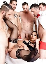 Busty TS superstar Chanel Santini in stockings and lingerie gets anal gangbanged.