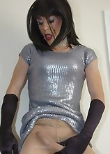 Tgirl Zoe in sexy silver dress showing big cock
