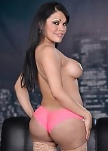 Busty Carmen posing her goodies