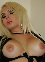 A Blond Blue Eyes and Naturally Busty Tranny stroking that fat shecock of hers