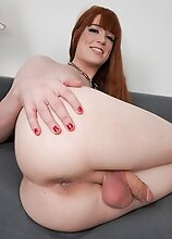 Redhead Erica Cherry shows off her body before taking out her huge cock and playing with it! Then, she strokes it until she pops a nice big load!