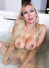 MILF Tranny with Very Big Tits in the Jaccuzzi