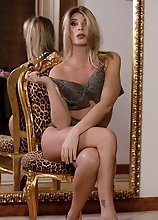 Angelina getting off with herself in front of the mirror and jerks her cock off on a chair