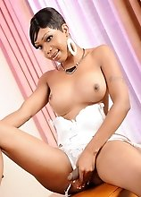 Ebony Sexxxy Jade posing in hot white costume